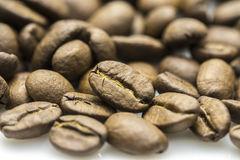 Roasted coffee beans isolated in white background Stock Photos