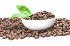 Roasted coffee beans isolated on a white background cutout. Brown coffee beans on a white background. Clipping path Royalty Free Stock Images