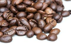 Roasted coffee beans isolated on a white background. royalty free stock photo