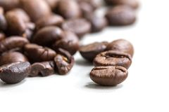 Roasted coffee beans isolated on a white background stock images