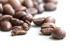 Roasted coffee beans isolated on a white background royalty free stock photo