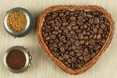 Roasted coffee beans on the kitchen table. Fresh coffee. Preparation of hot coffee. Refreshing drink. Sales of coffee beans. Stock Image