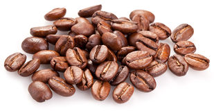 Roasted coffee beans and leaves. Royalty Free Stock Images