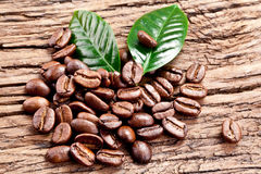 Roasted coffee beans and leaves. Royalty Free Stock Photography