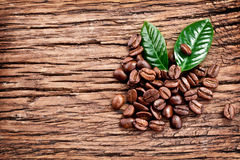 Roasted coffee beans and leaves. Stock Photo