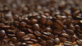 Roasted Coffee Beans, Left. Macro close up moving through lush a pile of roasted coffee beans stock footage