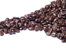 Roasted coffee beans line Royalty Free Stock Photos