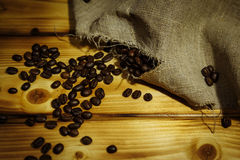 Roasted coffee beans. In a linen bag Stock Images