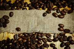 Roasted coffee beans. In a linen bag Royalty Free Stock Photos
