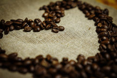 Roasted coffee beans. In a linen bag Royalty Free Stock Photo