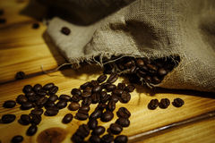 Roasted coffee beans. In a linen bag Stock Photo
