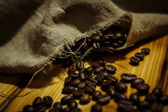 Roasted coffee beans. In a linen bag Stock Image