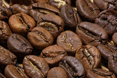 Roasted coffee beans. Macro shot with extended depth of field. Beans lay upside down. Light is rather hard Stock Photo