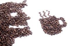 Roasted coffee beans in man and coffee mug shape Stock Photo