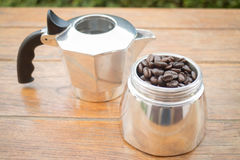 Roasted coffee beans in moka pot Royalty Free Stock Image