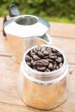 Roasted coffee beans in moka pot Stock Image