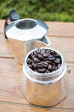 Roasted coffee beans in moka pot Royalty Free Stock Photography