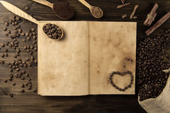 Roasted coffee beans on old vintage open book. Royalty Free Stock Image