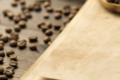 Roasted coffee beans on old vintage open book. Stock Photo