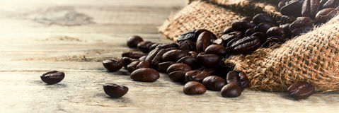 Roasted coffee beans on old wood background Royalty Free Stock Photography