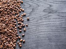 Roasted coffee beans on the old wooden background. Top view. stock image