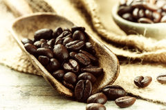 Roasted coffee beans with old wooden scoop Royalty Free Stock Photo