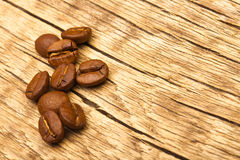 Roasted coffee beans on old wooden table Royalty Free Stock Photo
