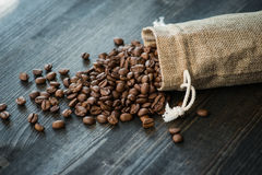 Roasted coffee beans on old wooden table Stock Photo