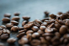 Roasted coffee beans on old wooden table Royalty Free Stock Image