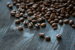 Roasted coffee beans on old wooden table Royalty Free Stock Photography