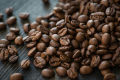 Roasted coffee beans on old wooden table Stock Photos