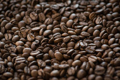 Roasted coffee beans on old wooden table Royalty Free Stock Photos