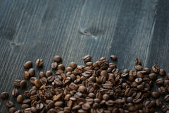 Roasted coffee beans on old wooden table Stock Image