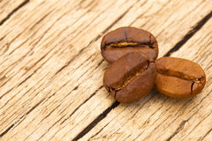 Roasted coffee beans on old wooden table - view from top Stock Image