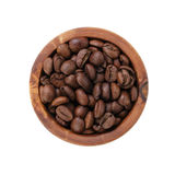 Roasted coffee beans in olive wood bowl from above Stock Images