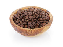 Roasted coffee beans in olive wood bowl Stock Photography