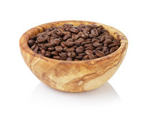 Roasted coffee beans in olive wood bowl Royalty Free Stock Photos