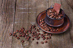 Roasted coffee beans over rustic wooden background Royalty Free Stock Photo