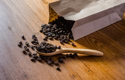roasted coffee beans from paper bag stock photography