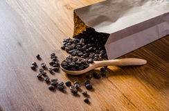 roasted coffee beans from paper bag stock photos