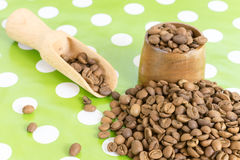 Roasted coffee beans in a pile on the table Stock Photos
