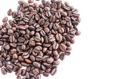 Roasted coffee beans pile from top on white background Royalty Free Stock Photos