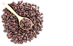 Roasted coffee beans pile from top on white background Stock Photos