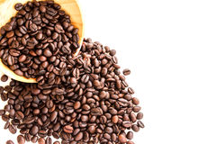 Roasted coffee beans pile from top on white background Stock Image