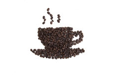 Roasted coffee beans placed in the shape of a cup. And saucer on a white surface Stock Photos