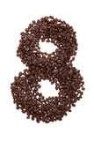 Roasted coffee beans placed in the shape of number eight Stock Photography