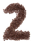 Roasted coffee beans placed in the shape of number two Stock Photos