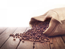 Roasted coffee beans poured Stock Photography