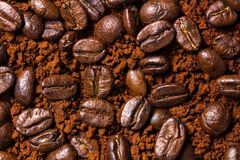 Roasted coffee beans and powder. Background stock images