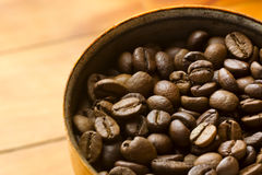 Roasted coffee beans ready to be crushed. Stock Photography